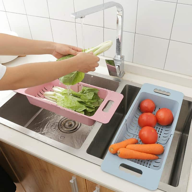 A woman preparing food in a kitchen