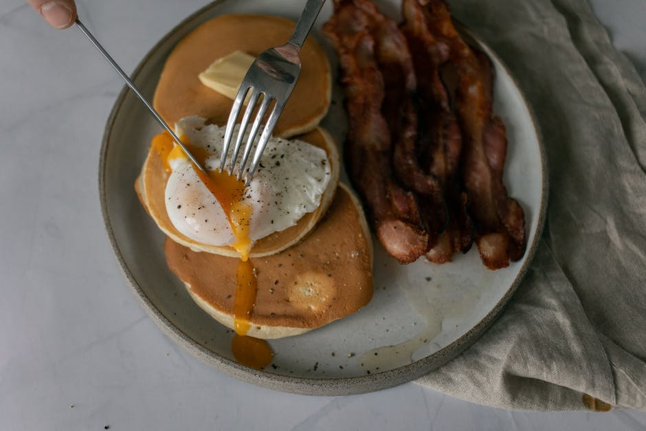 A plate of food with a fork and knife